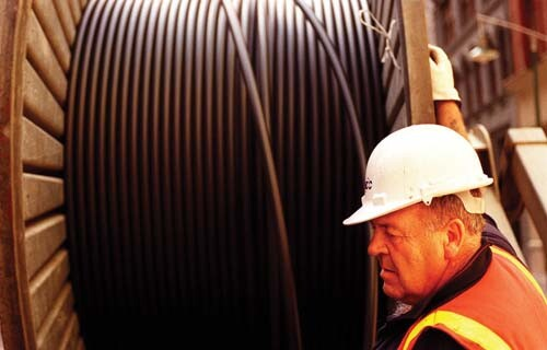 fiber-optic roll-out with worker