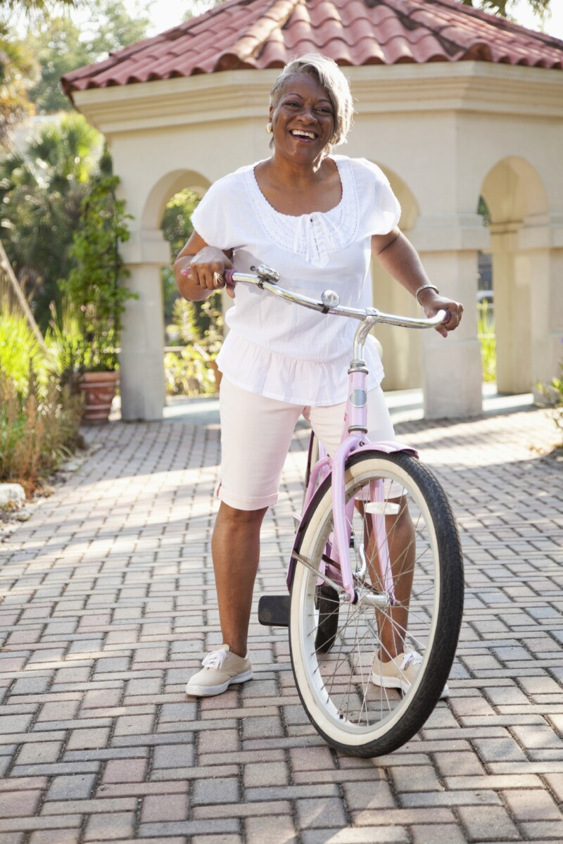 Mature African American woman with bicycle