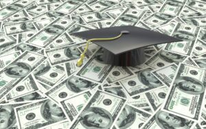 Student loan graphic of graduation cap on hundred dollar bills