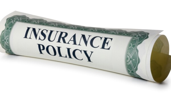 insurance policy rolled up in scroll