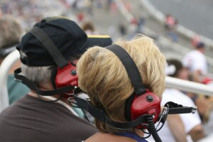 Couple wearing ear protection at NASCAR race