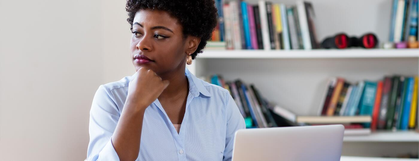 African american businesswoman with depression at work