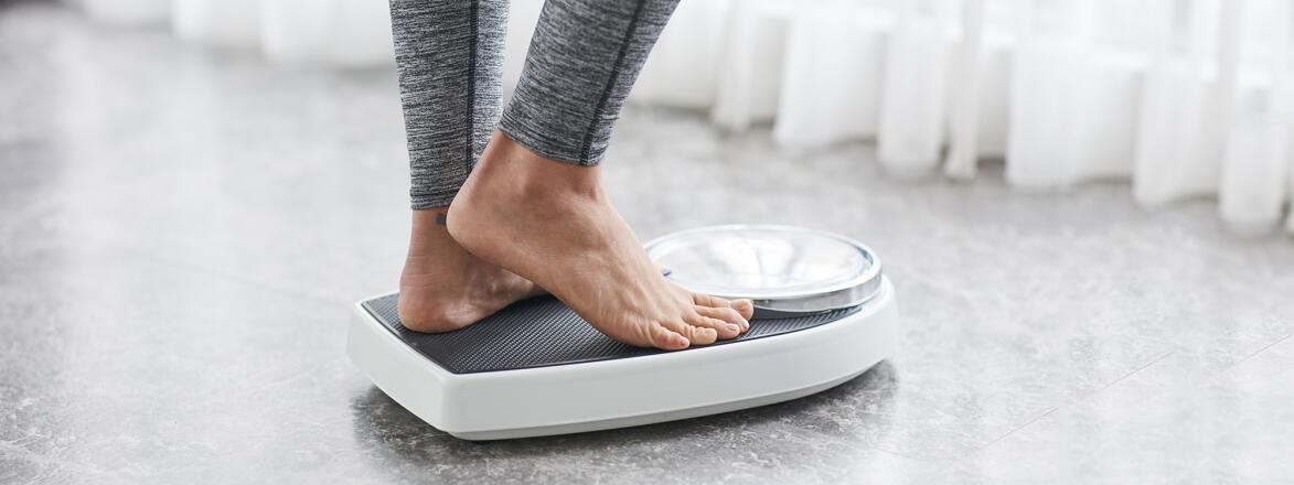 woman using a scale at home