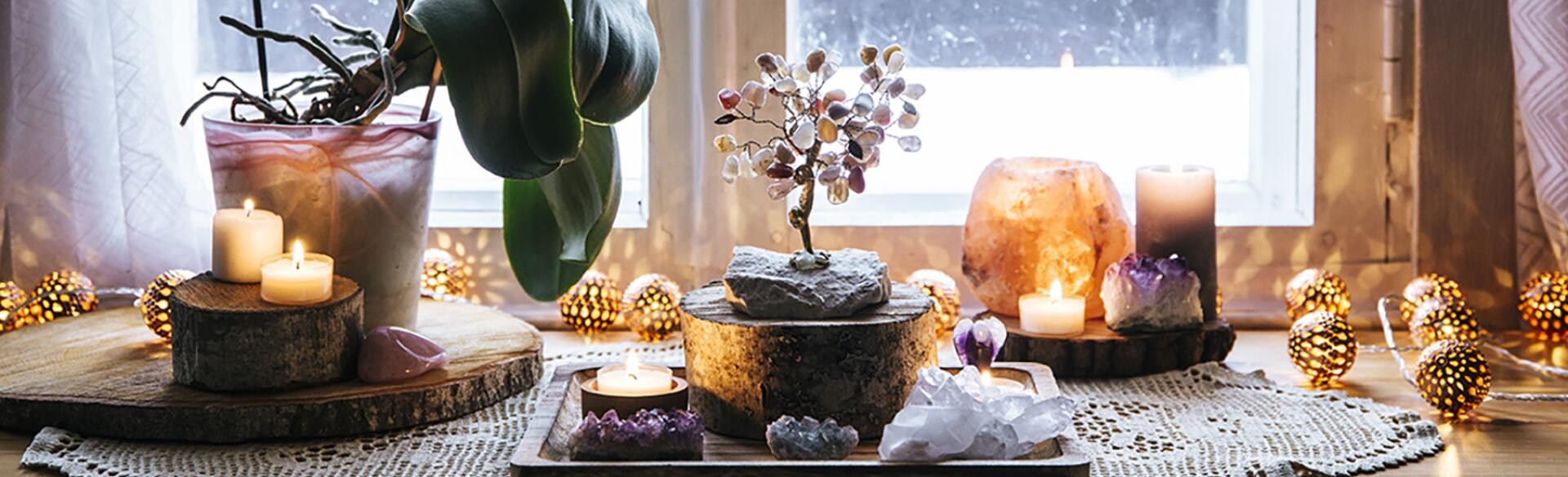 image_of_plant_candles_crystals_on_window_sill_GettyImages-1153716253_1800