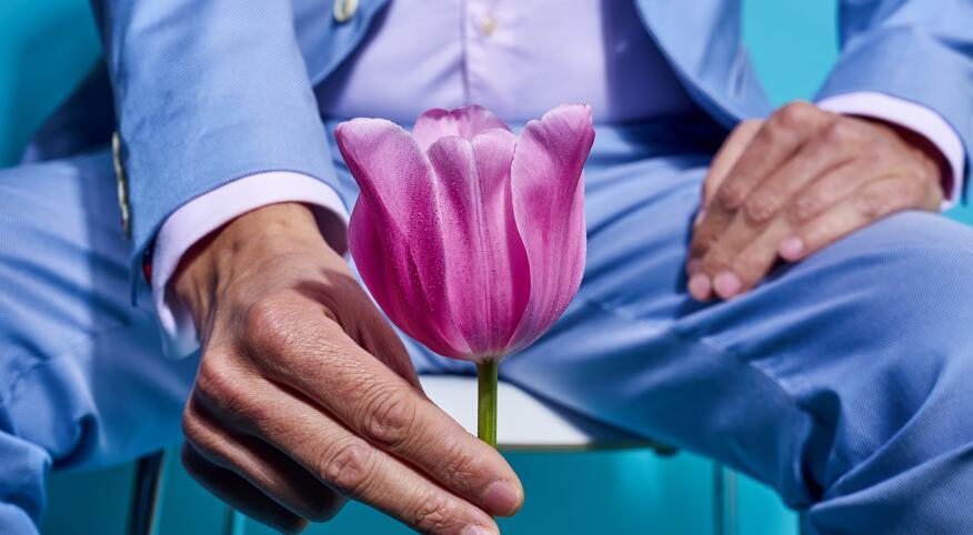 Man holding Tulip flower