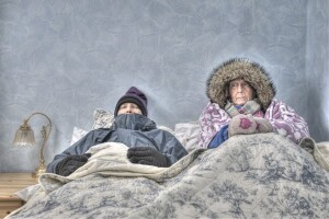 Older couple cold and miserable in bed