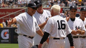 Whitey Ford, right, walks up to Reggie Jackson during The New York Yankees 65th Old Timers Day.