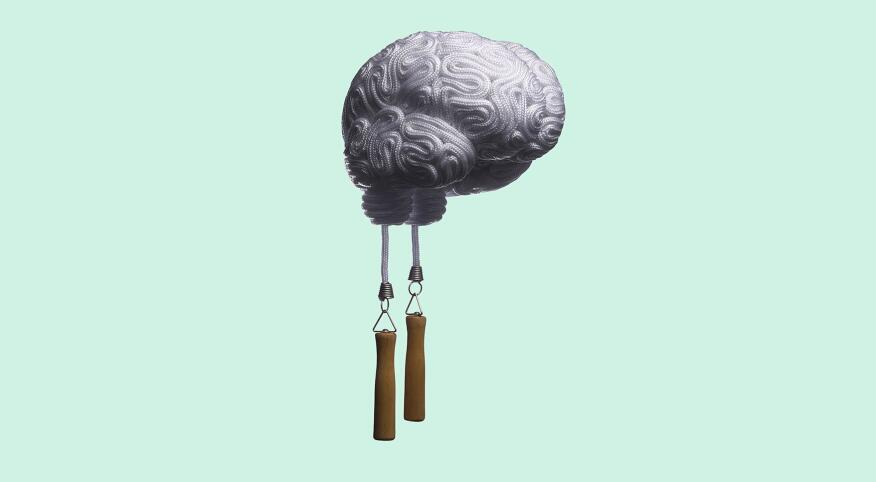 A jump rope in the shape of a brain on green background