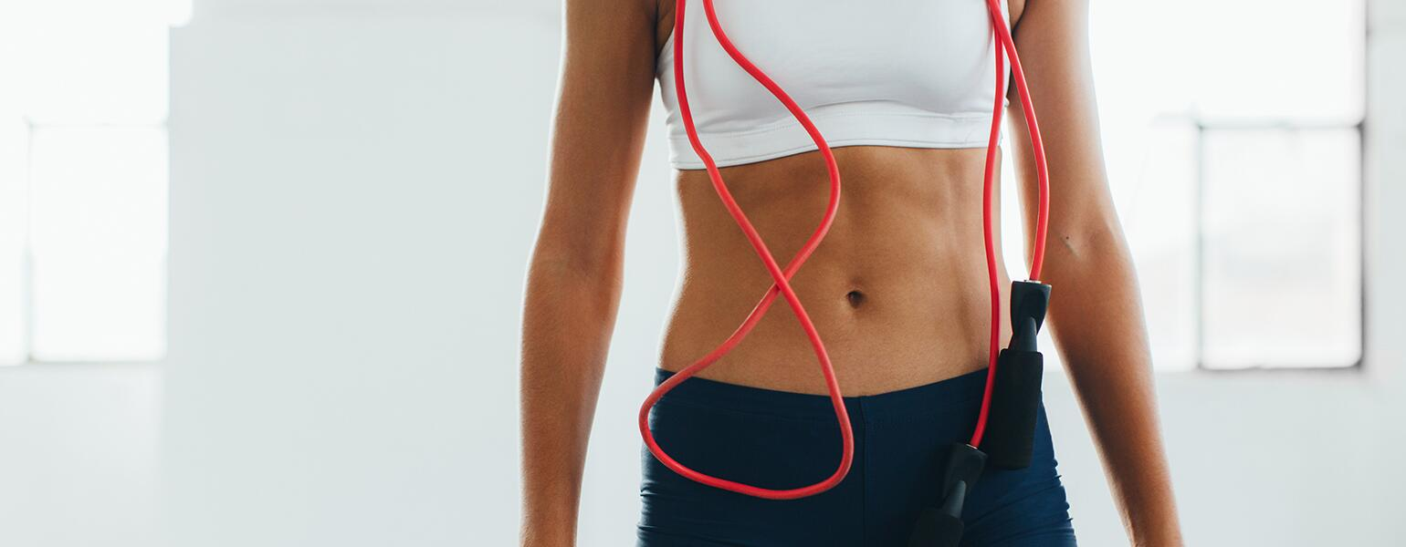 image_of_womans_flat_stomach_with_jumprope_hanging_from_neck_Stocksy_txpa33217d90LZ200_OriginalDelivery_1183186_1540.jpg