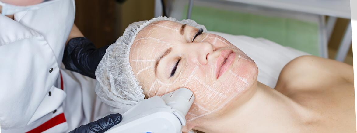A photo of a woman undergoing an ultherapy treatment.