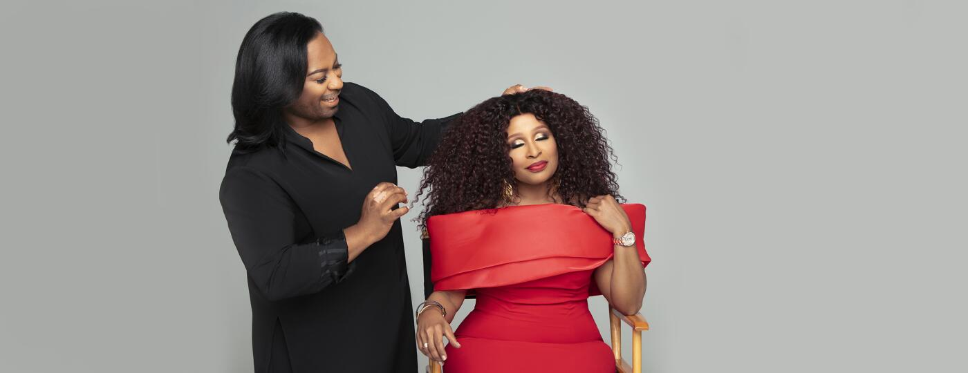 Woman getting fitted for wig by stylist