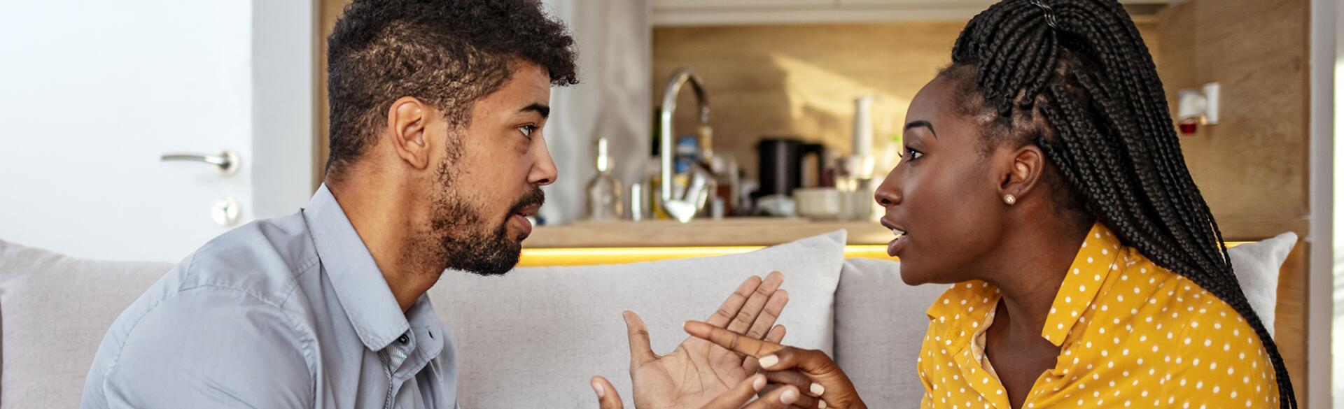 Black woman and man quarreling at home