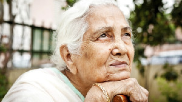 One sad pensive senior Indian woman