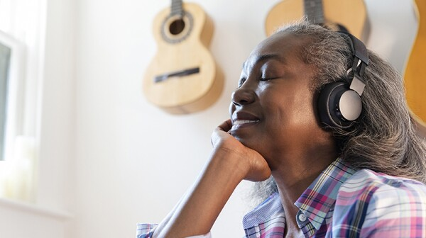 A woman listening to something with headphones on