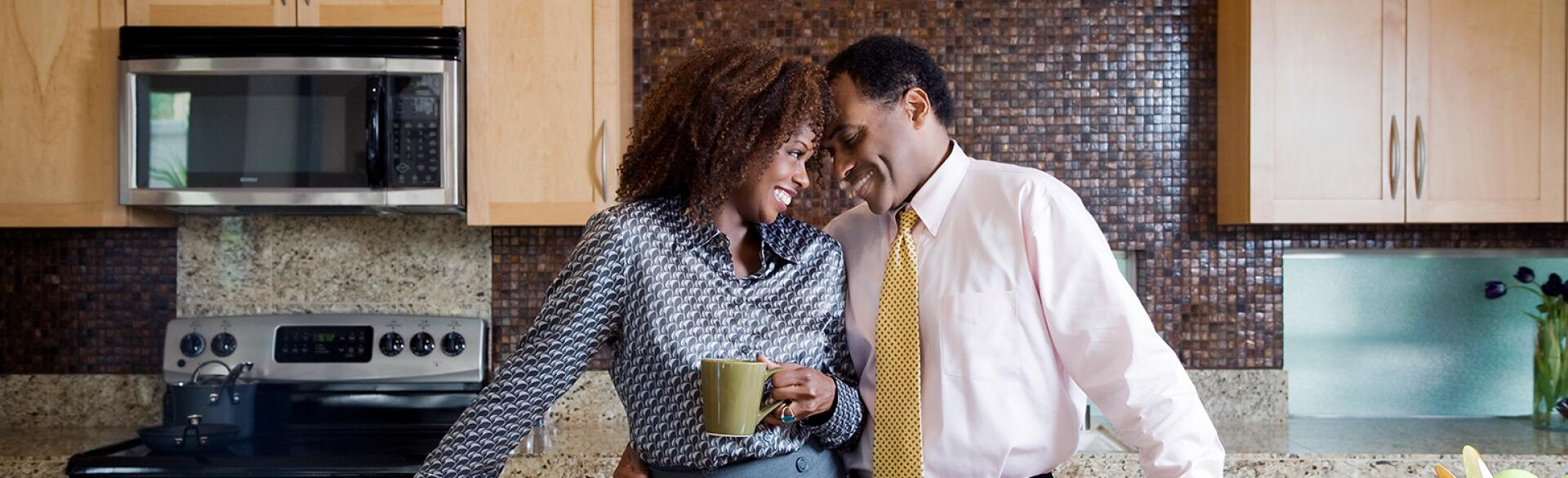 image_of_black_couple_touching_foreheads_in_kitchen_GettyImages-91497683_1540.jpg