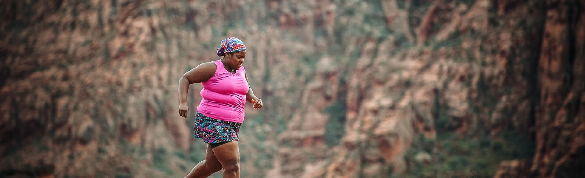 Plus size middle age woman running a marathon