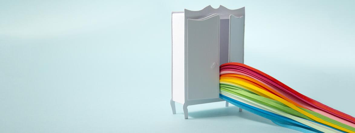 wardrobe with rainbow coming out of it to represent coming out of the closet