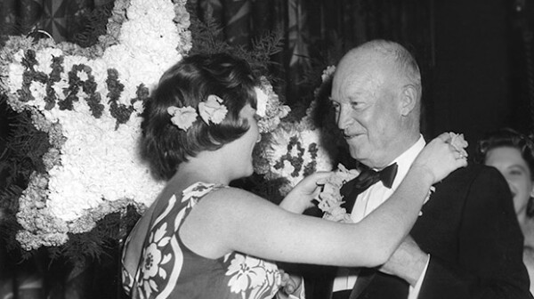 President Dwight D. Eisenhower receives lei in celebration of Hawaii Statehood