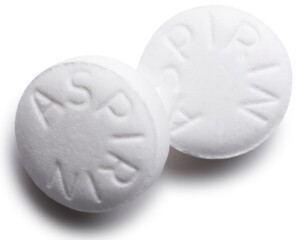Two white aspirin tablets