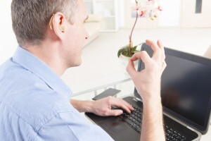 Deaf man talking using sign language on the laptop's camera