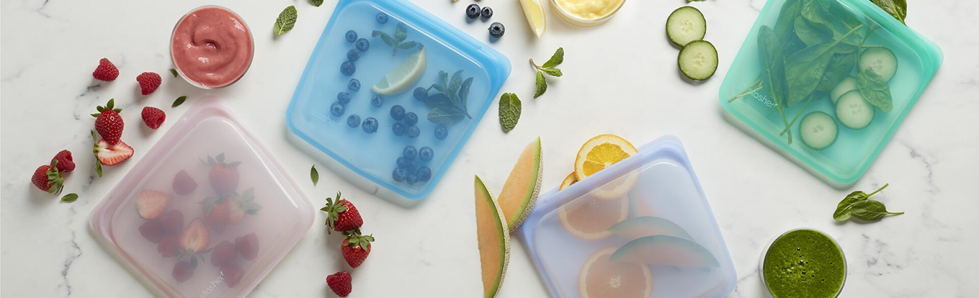 reusable lunch bags filled with fruits and vegetables