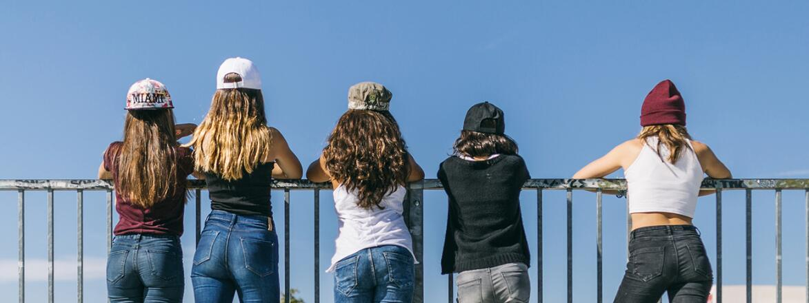 Back View Of A Group Of Stylish Teen Girls