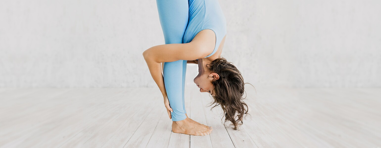 Woman Doing Yoga In Studio