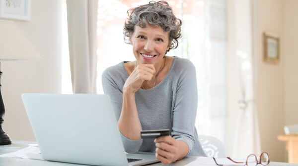 Senior woman shopping online