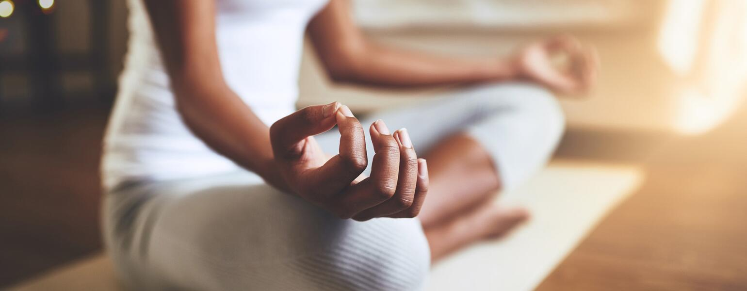 woman practicing guided meditation at home