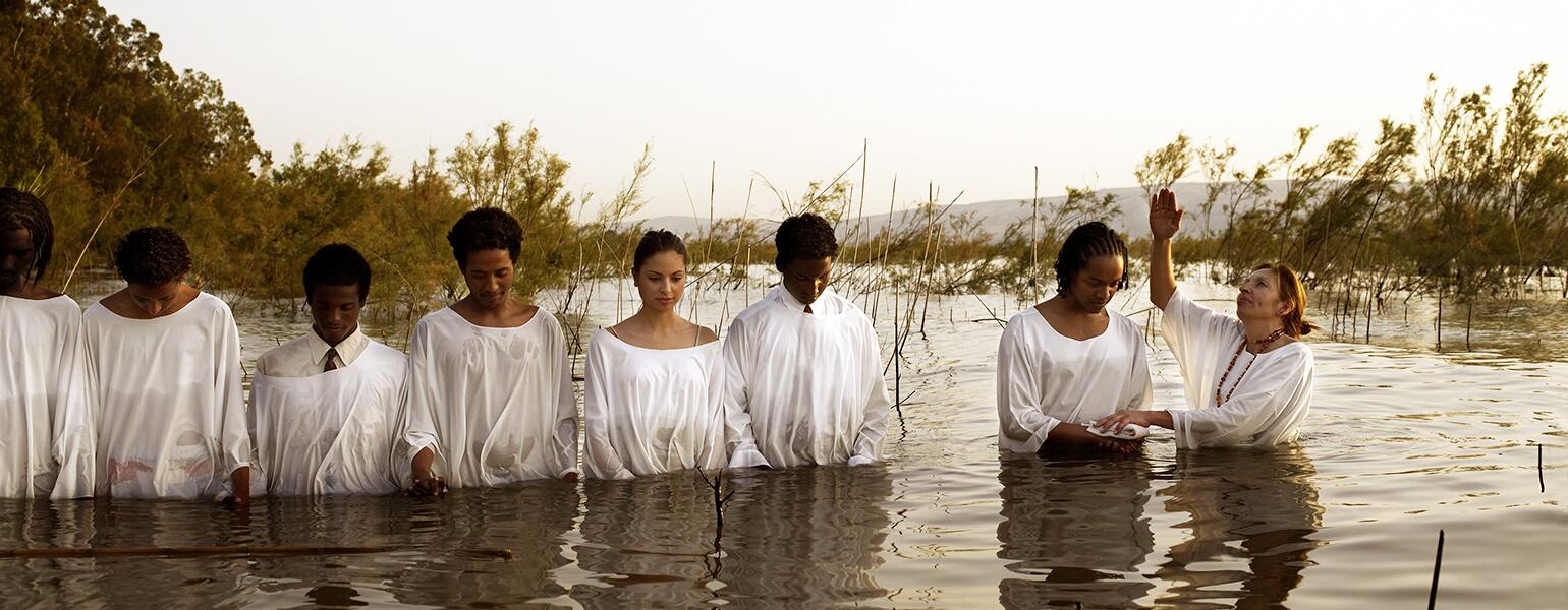 image_of_baptism_in_body_of_water_GettyImages-200240947-002_1540.jpg