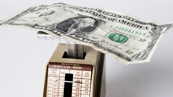 Inflation - Dollar Bill on Scale
