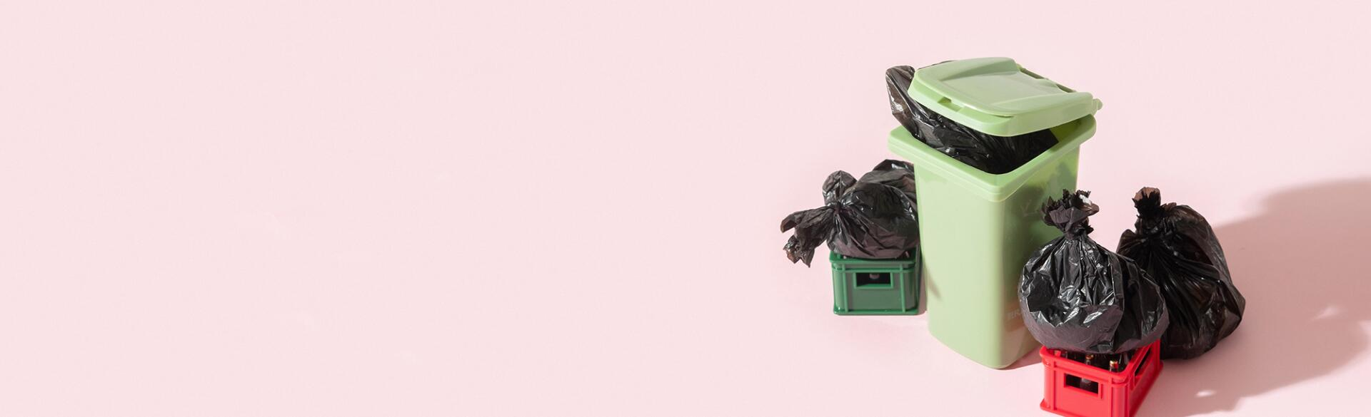 Garbage can, trash and recycling on pink background