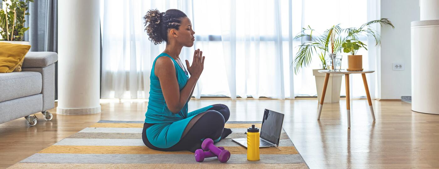 image_of_woman_meditating_with_hands_together_GettyImages-1251369317_1800