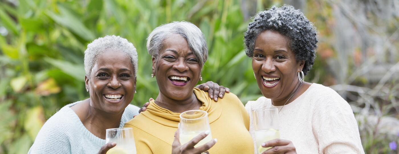 image_of_three_senior_women_smiling_ and_holding_drinks_GettyImages-466376634_1800