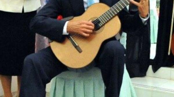 John Kerry Plays Guitar