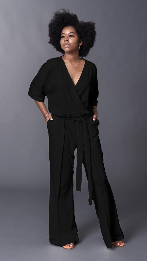 A female black model wears the Black Gail Jumper by Tracy Nicole