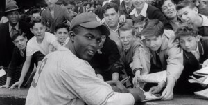 Jackie Robinson signing autographs