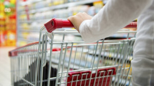 Mystery shopper pushing grocery cart