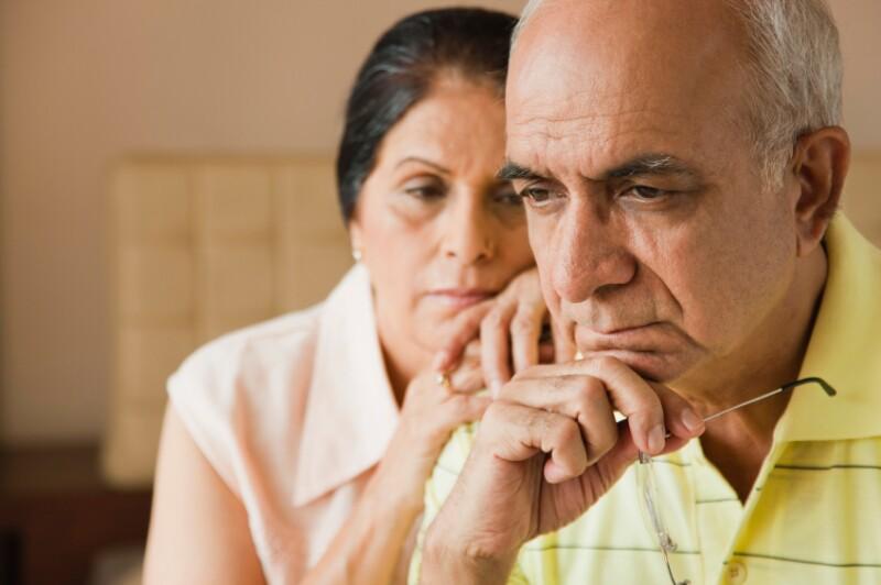 Pensive older couple