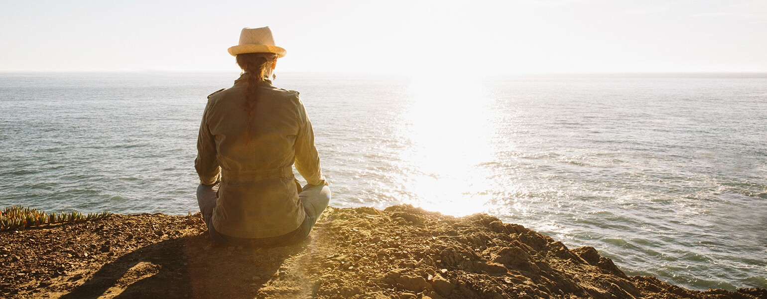 Woman Meditating In Nature By Ocean