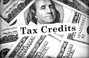 Pile of hundred dollar bills around tax credits