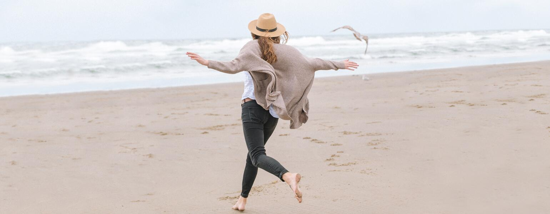single woman running on the beach