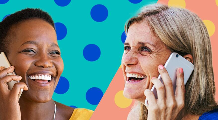 Two women talking on their phones and smiling.