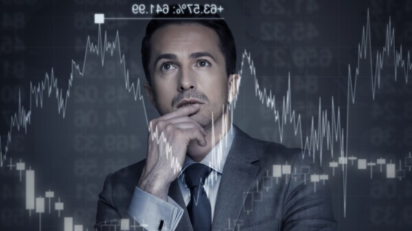 Man contemplates stock market chart