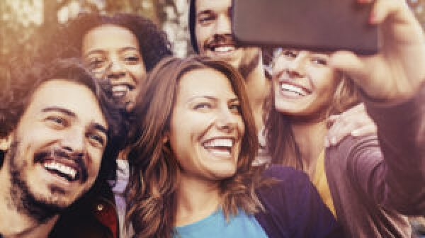 Millennials taking group selfie