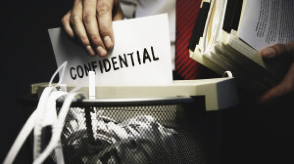 Man shredding confidential documents