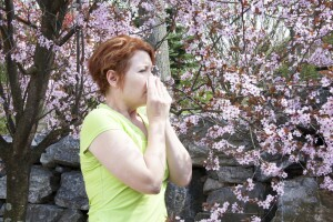 Woman sneezing around pollen