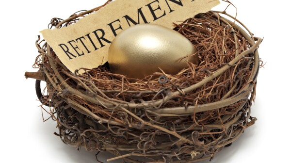 "Nest egg with gold egg and parchment reading ""retirement"""