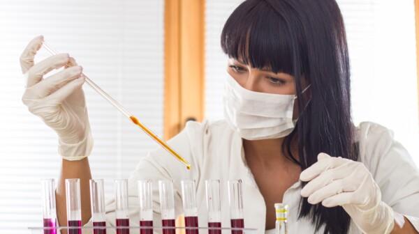 Scientist in white uniform working in laboratory