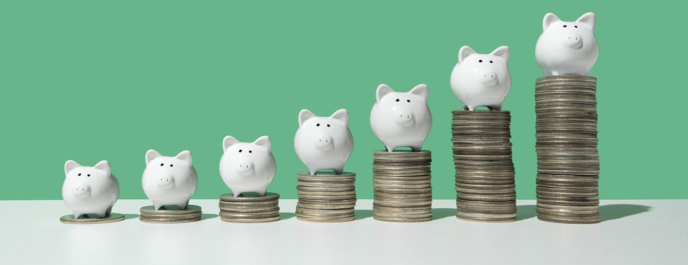 image_of_piggy_banks_on_stacks_of_coins_GettyImages-1072593728_1800